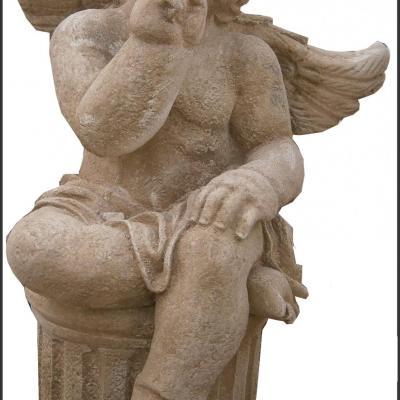 Petit ange en pierre reconstituée