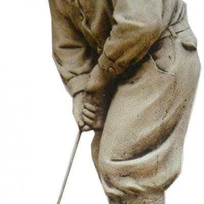 Petit garçon golfeur